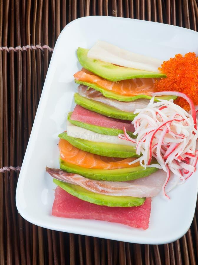 Japanese cuisine. sashimi on the background. Japanese cuisine. sashimi on background royalty free stock images