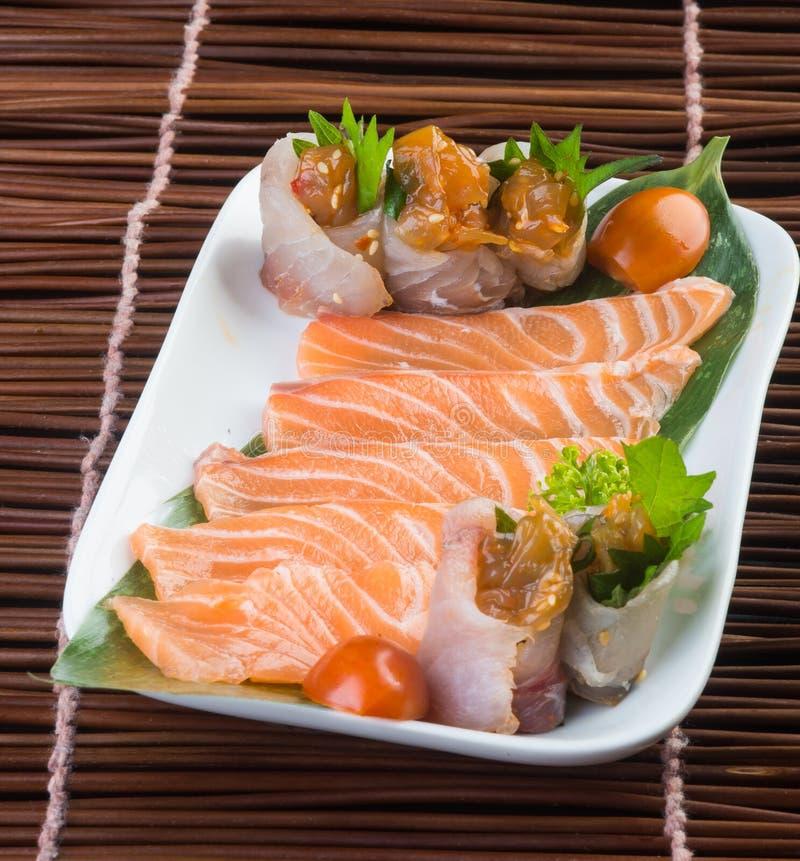 Japanese cuisine. sashimi on the background. Japanese cuisine. sashimi on background stock images