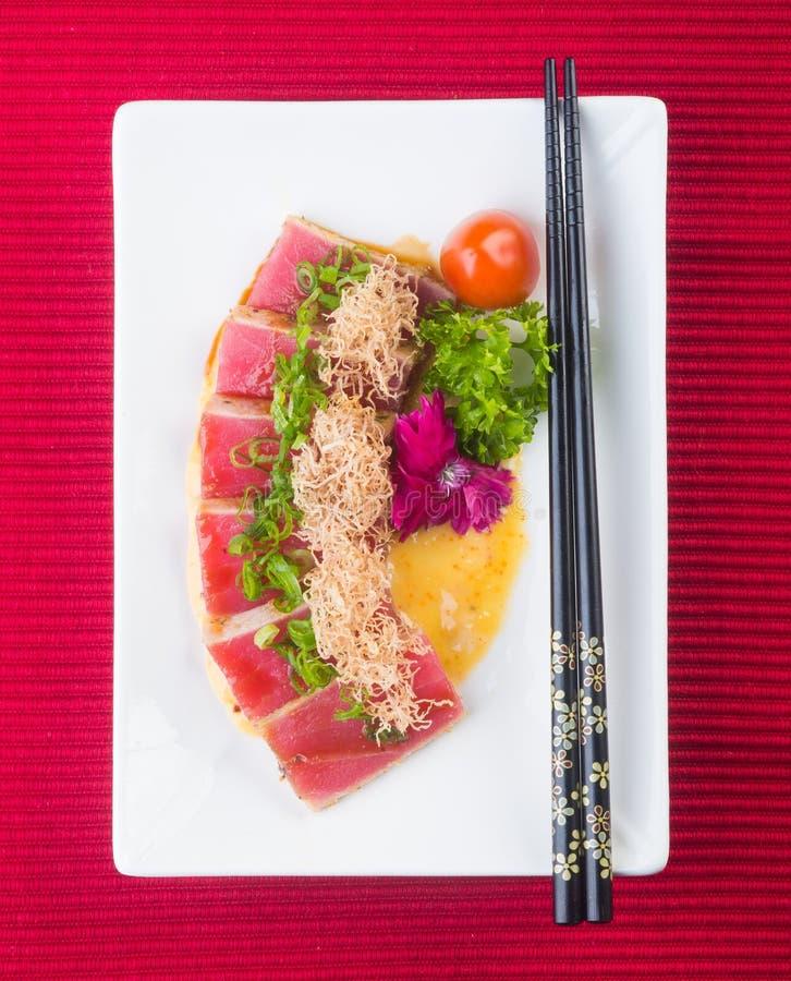 Japanese cuisine. sashimi on the background. Japanese cuisine. sashimi on background stock photos