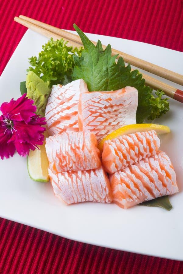 Japanese cuisine. sashimi on the background. Japanese cuisine. sashimi on background royalty free stock photo