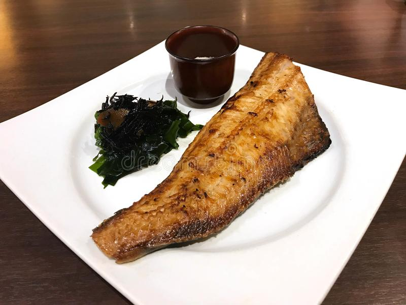 Japanese cuisine, Charcoal grilled Atka Mackerel or Shima Hokke. Japanese cuisine, Set of charcoal grilled Atka Mackerel or Shima Hokke on white plate stock image