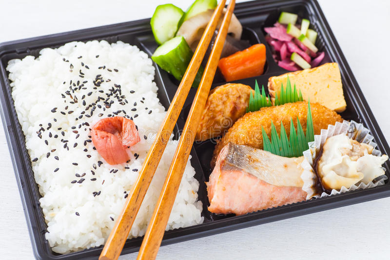 Japanese cuisine a single-portion takeout. Traditional bento japanese cuisine a single-portion takeout or home-packed meal royalty free stock photo