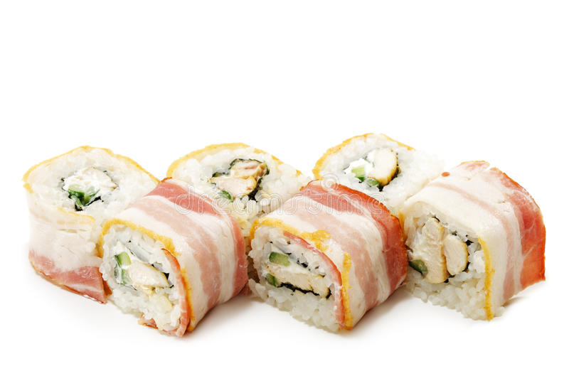 Japanese Cuisine - Sushi. With Chicken and Cucumber Wrapped in Bacon stock images