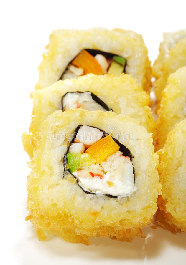Japanese Cuisine - Sushi. Roll with Crab Meat, Pepper, Avocado and Cream Cheese royalty free stock photos