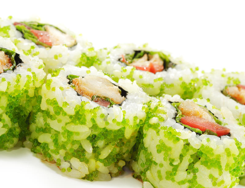 Japanese Cuisine - Sushi. Roll with Sea Bass, Tomato and Green Flying Fish Roe royalty free stock photos