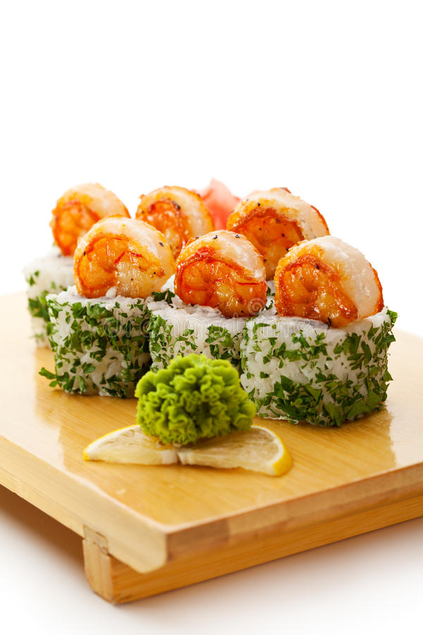 Japanese Cuisine - Sushi. Roll with Cream Cheese inside. Topped with Shrimps and Dill outside stock photo