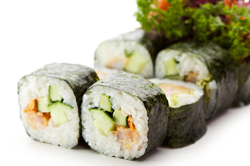 Japanese Cuisine - Sushi. Roll with Shrimps and Cucumber inside, Nori outside. Served with Parsley, Salad Leaf and Shrimps stock images