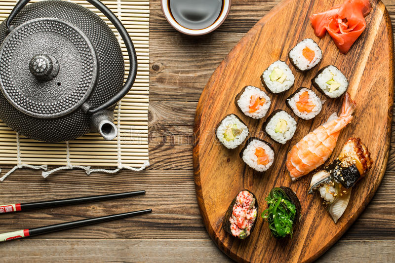 Japanese cuisine, sushi and rolls in traditional setting stock image