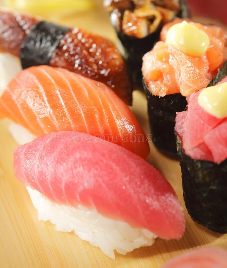 Japanese Cuisine - Sushi Set. Salmon, Conger and Tuna Sushi with Salad Leaf stock image