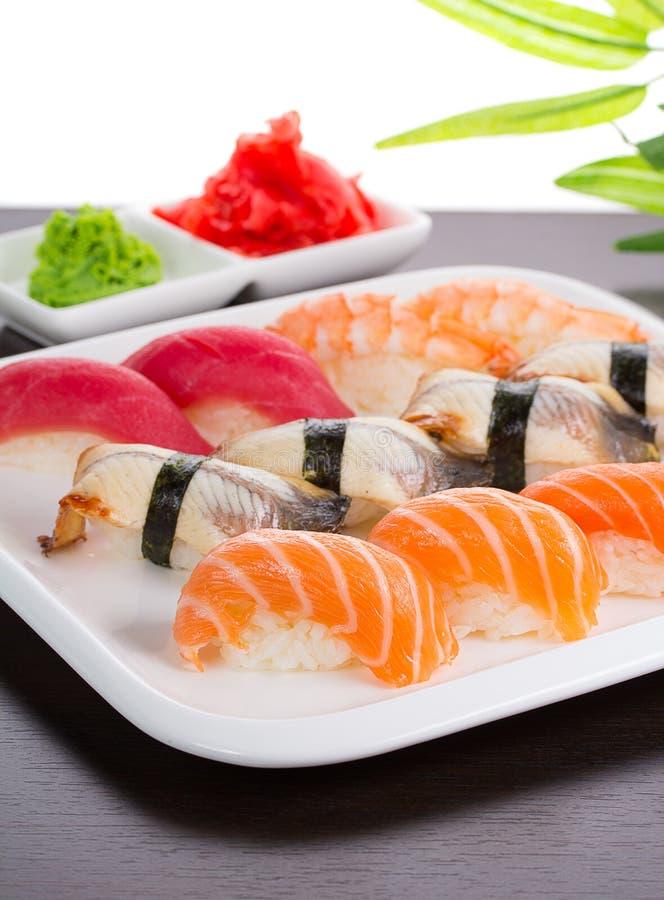 Japanese cuisine. Sushi. Japanese cuisine. Set of sushi nigiri on white plate royalty free stock photos