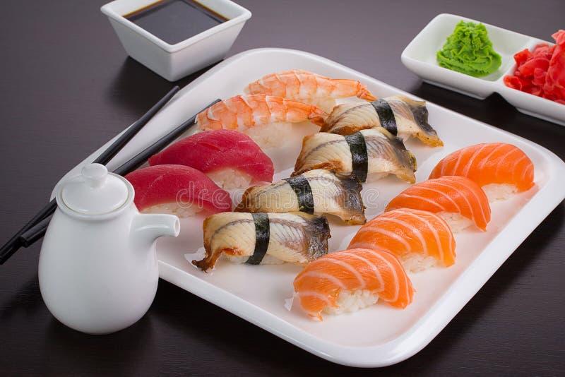 Japanese cuisine. Sushi. Japanese cuisine. Set of sushi nigiri on white plate royalty free stock photo