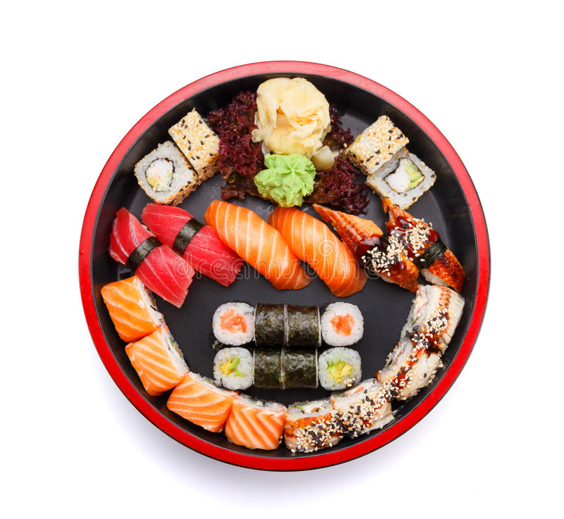 Japanese cuisine. Sushi. Japanese cuisine. Sushi set on a round wooden plate isolated on white background stock image