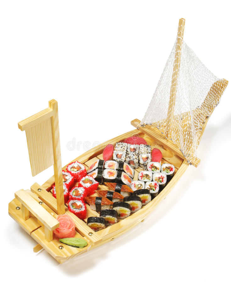 Japanese Cuisine - Sushi Ship. Japanese Cuisine - Wooden Ship with Various Type of Sushi royalty free stock images