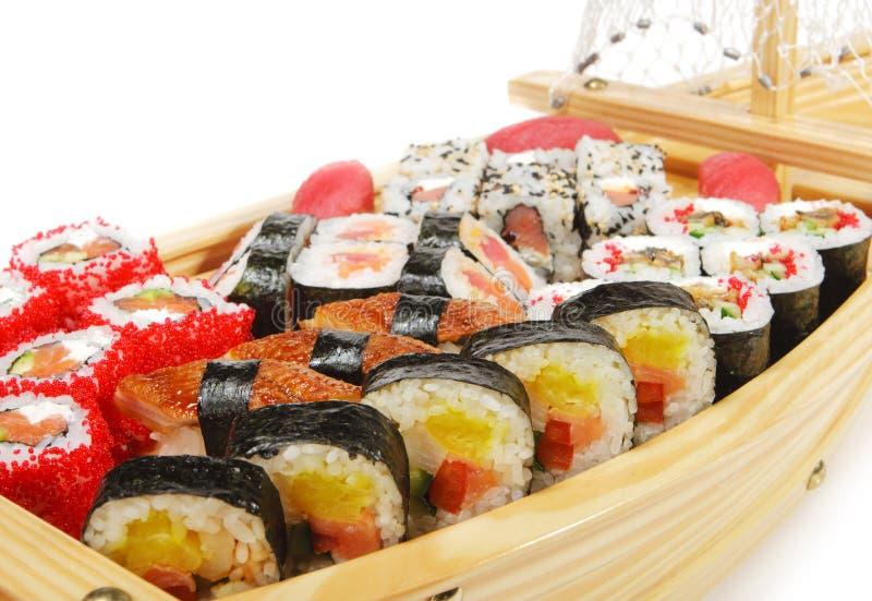 Japanese Cuisine - Sushi Ship. Japanese Cuisine - Wooden Ship with Various Type of Sushi stock photo