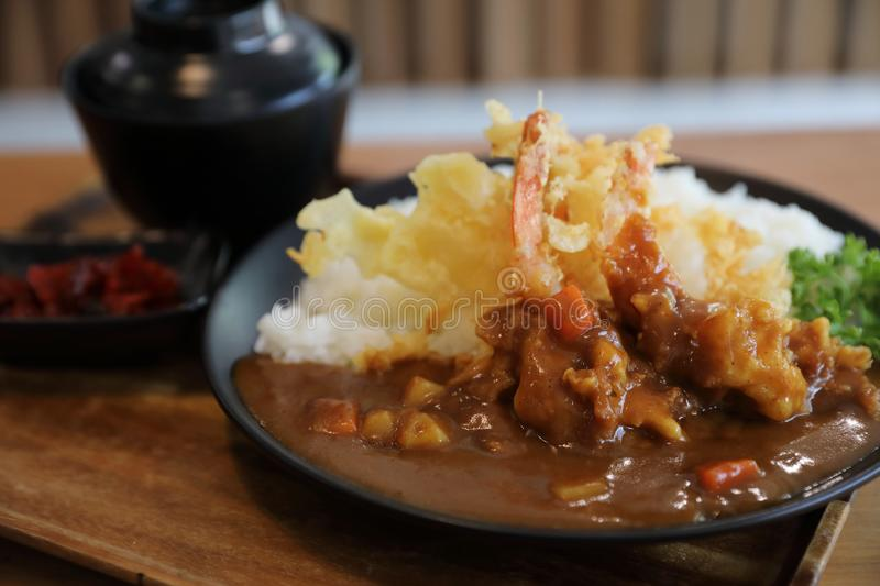 Japanese curry rice with fried shrimp tempura Japanese food. Japanese curry rice with fried shrimp tempura royalty free stock images