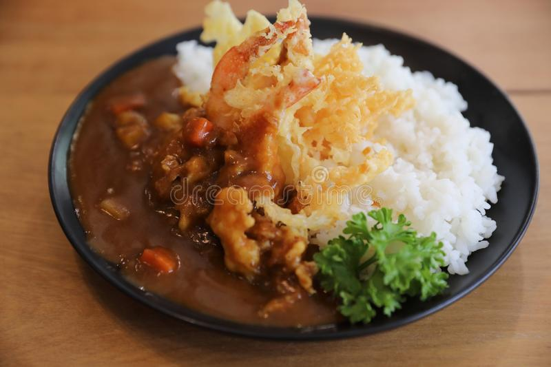 Japanese curry rice with fried shrimp tempura, Japanese food. Japanese curry rice with fried shrimp tempura royalty free stock photography