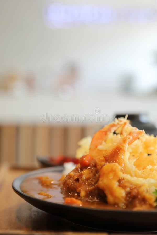 Japanese curry rice with fried shrimp tempura, Japanese food. Japanese curry rice with fried shrimp tempura stock photo