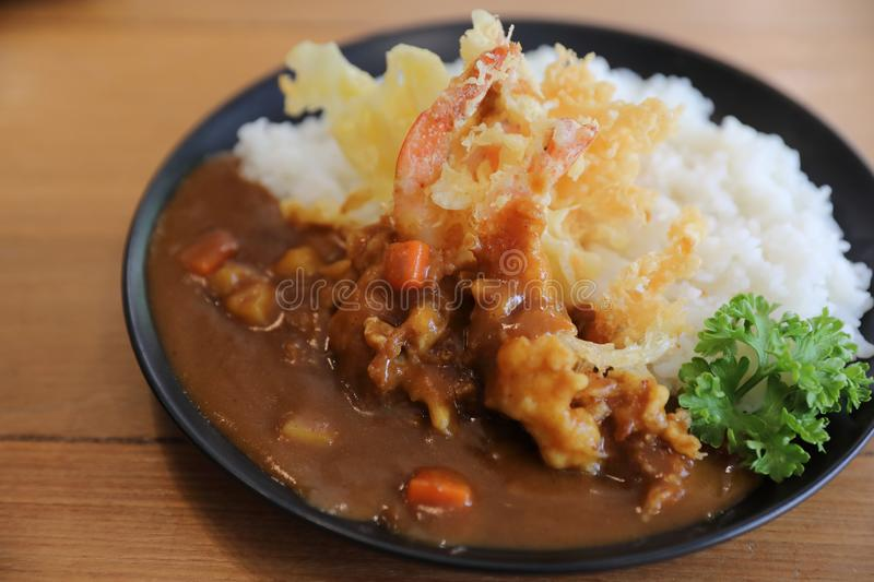 Japanese curry rice with fried shrimp tempura, Japanese food. Japanese curry rice with fried shrimp tempura in closeup, Japanese food stock image