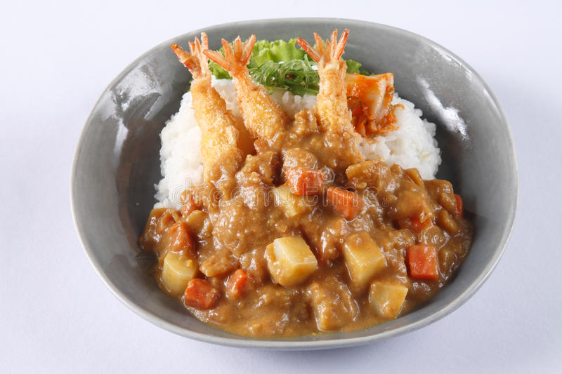 Japanese curry rice with shrimp tempura isolated on white backgr stock photos