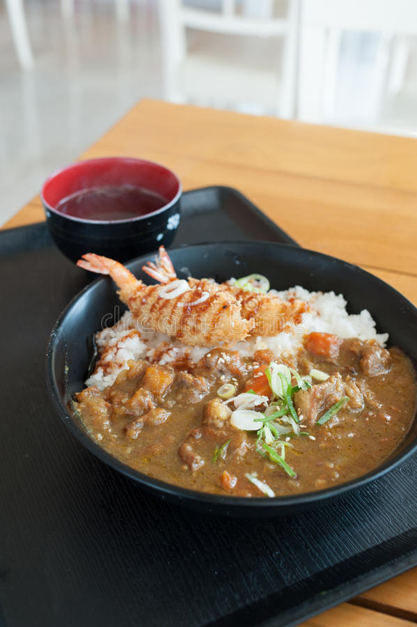 Japanese curry rice with shrimp tempura stock photography