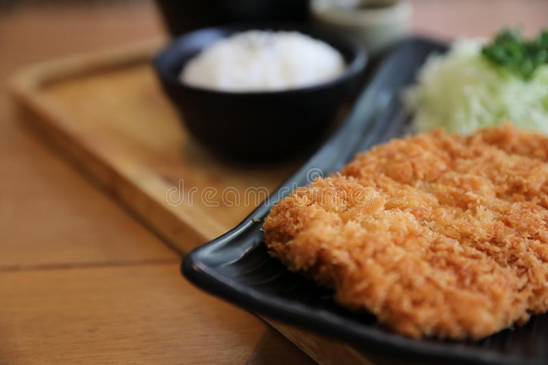 Japanese deep fried pork cutlet with rice, Japanese food. Japanese deep fried pork cutlet with rice on wooden tray, Japanese food stock photos