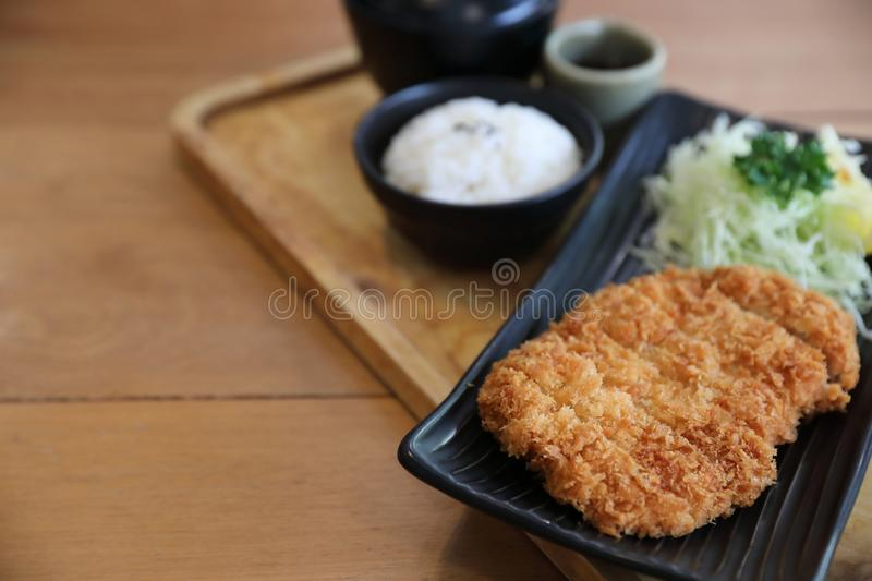 Japanese deep fried pork cutlet with rice, Japanese food. Japanese deep fried pork cutlet with rice on wooden tray, Japanese food stock images