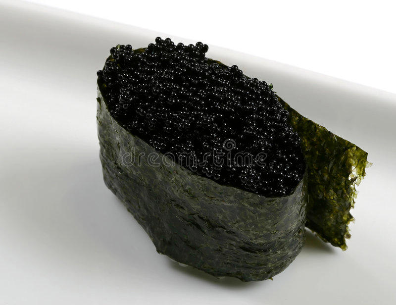 Japanese delicacy food! Black caviar roll royalty free stock image