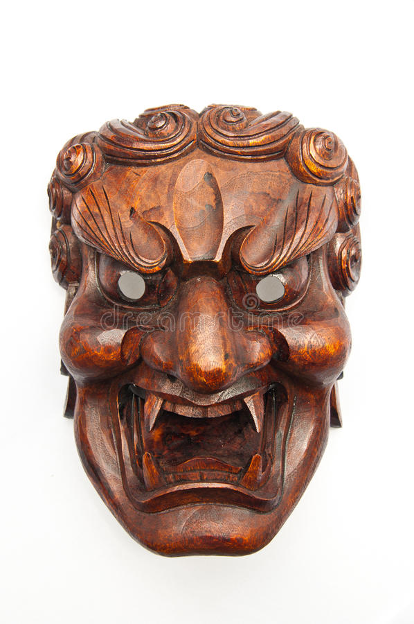 Japanese demon mask carving royalty free stock image
