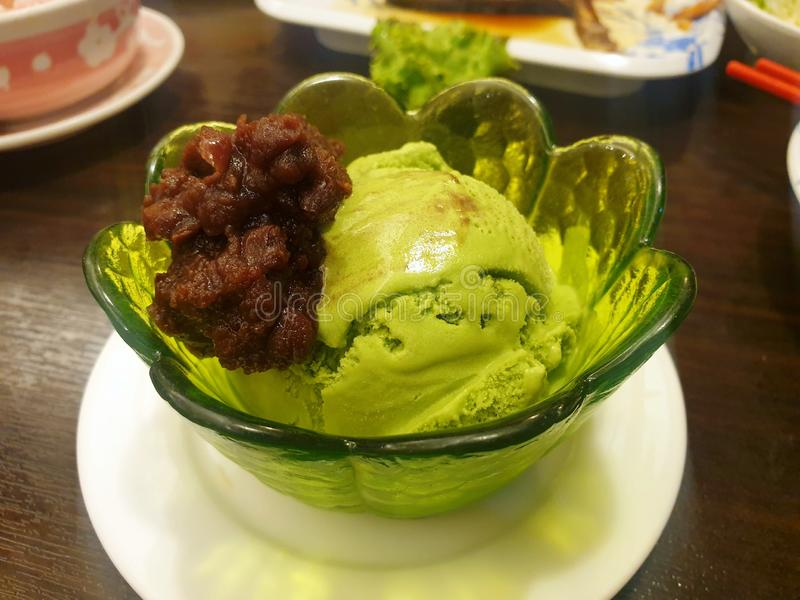 Japanese dessert style, Top view of green tea ice cream with red bean topping stock images