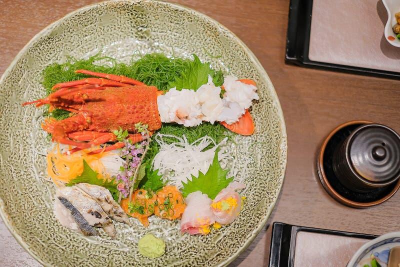Japanese Dinner set; lobster, fish and appetizer on wooden table in Traditional ryokan resort at Kawaguchiko lake, Yamanashi, royalty free stock photos
