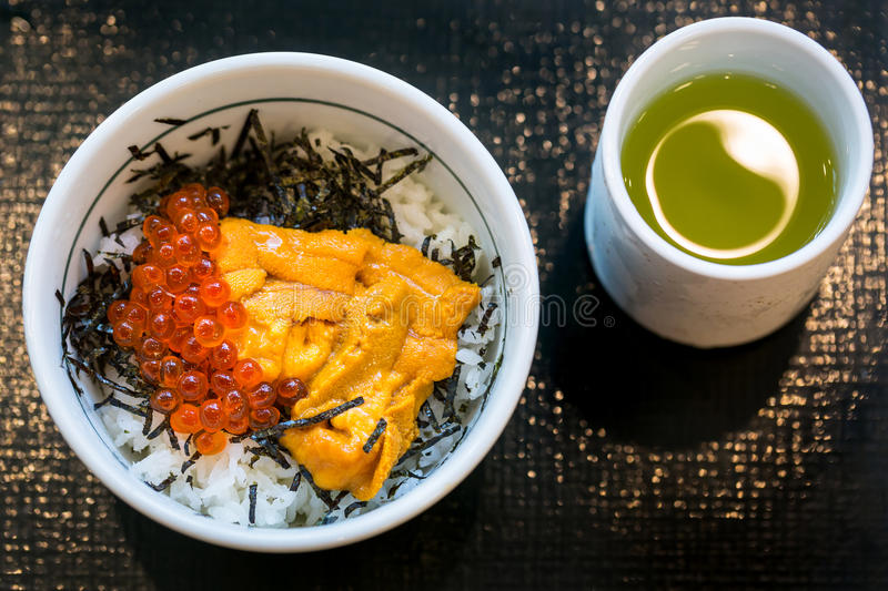 Japanese dish of salmon roe and urchin eggs stock photo