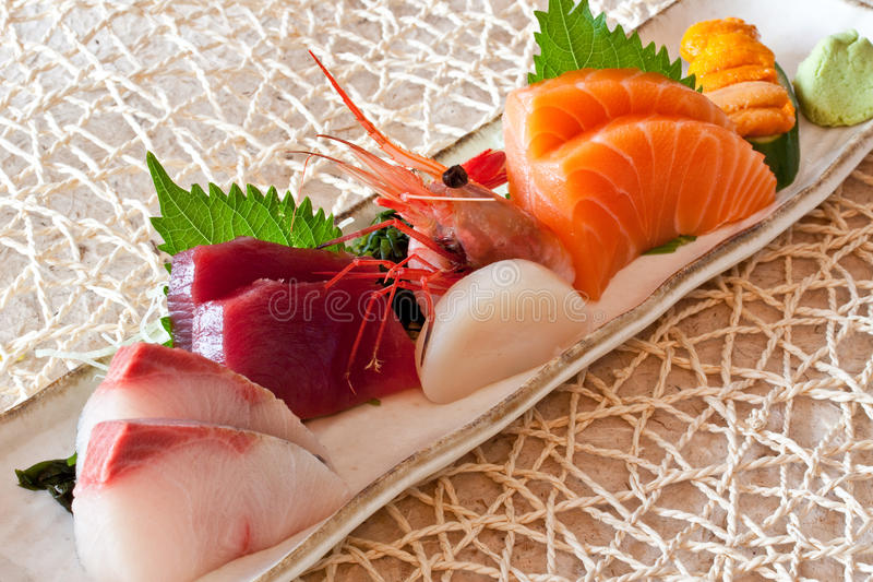 Japanese dishes - sashimi. A set of nice presentation sashimi dish - tuna, salmon, yellow tail, giant sweet shrimp, sea urchin and hokkaido scallop sashimi with stock photos