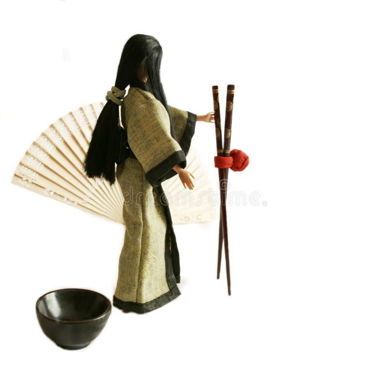 Free Japanese Doll Holding Chopsticks Royalty Free Stock Images - 746109