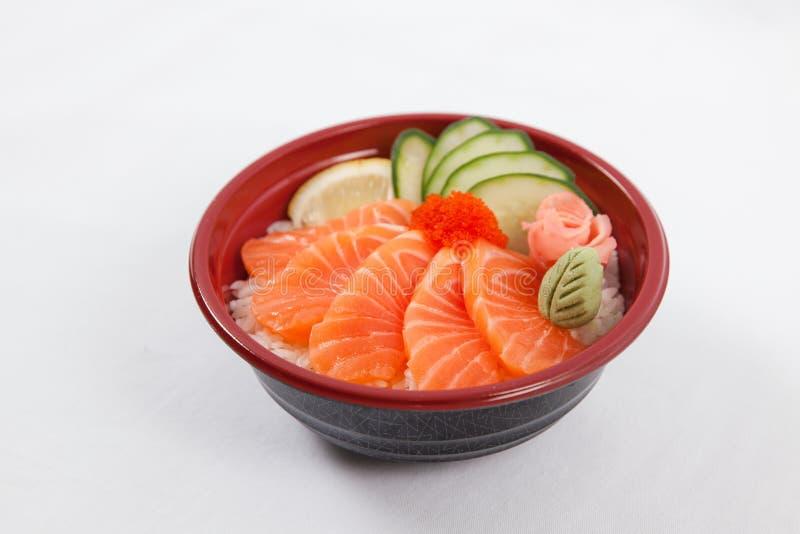 Japanese donburi. Sakedon, sliced salmon royalty free stock image
