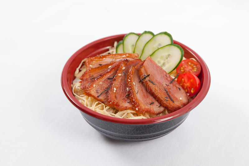 Japanese donburi. With sliced duck meat royalty free stock photography