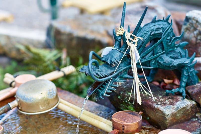 Japanese dragon fountain. Traditional japanese dragon fountain in buddhist shrine  in Nagoya, Japan stock photos