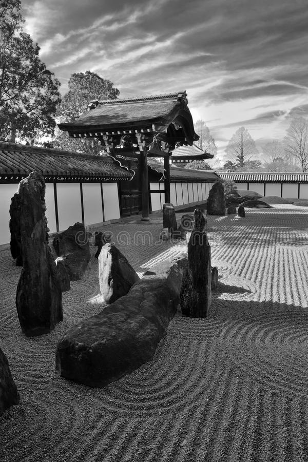 Japanese Dry Landscape Garden. Black and white study of the dry landscape garden showing rocks surrounded by ripples of raked gravel, symbolic of a spiritual stock photos