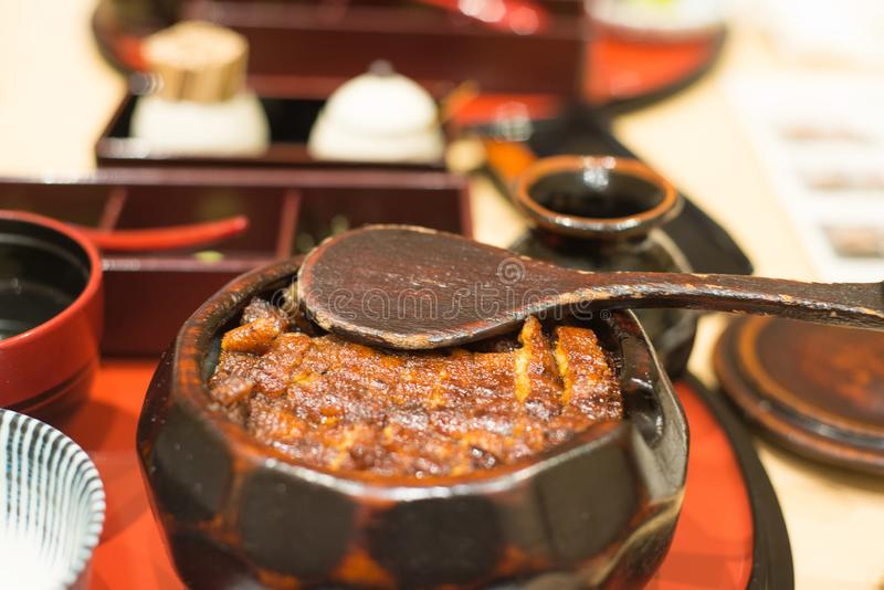Japanese eel grilled with rice or Unagi don set in wooden bowl royalty free stock photography