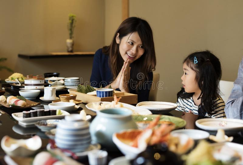 Japanese family dining together with happiness stock image