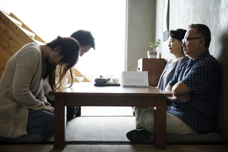 Japanese family greeting bowing with senior stock photography
