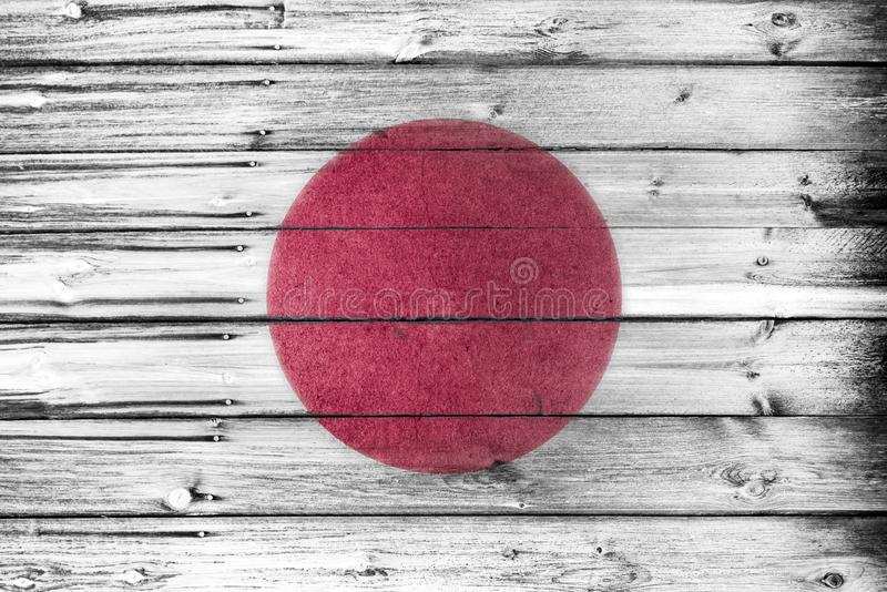 The japanese flag painted and weathered on rustic wooden board wall. stock images