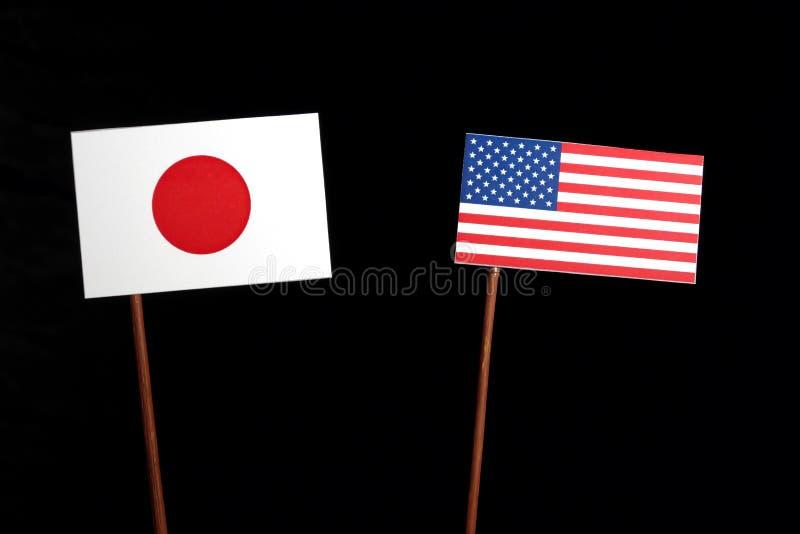 Japanese flag with USA flag on black. Background stock image