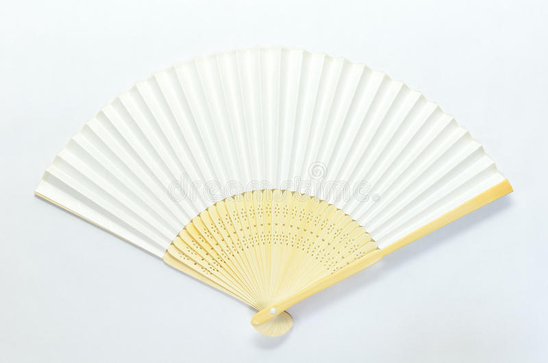 Japanese folding fan. The�@Japanese folding fan on white background royalty free stock images