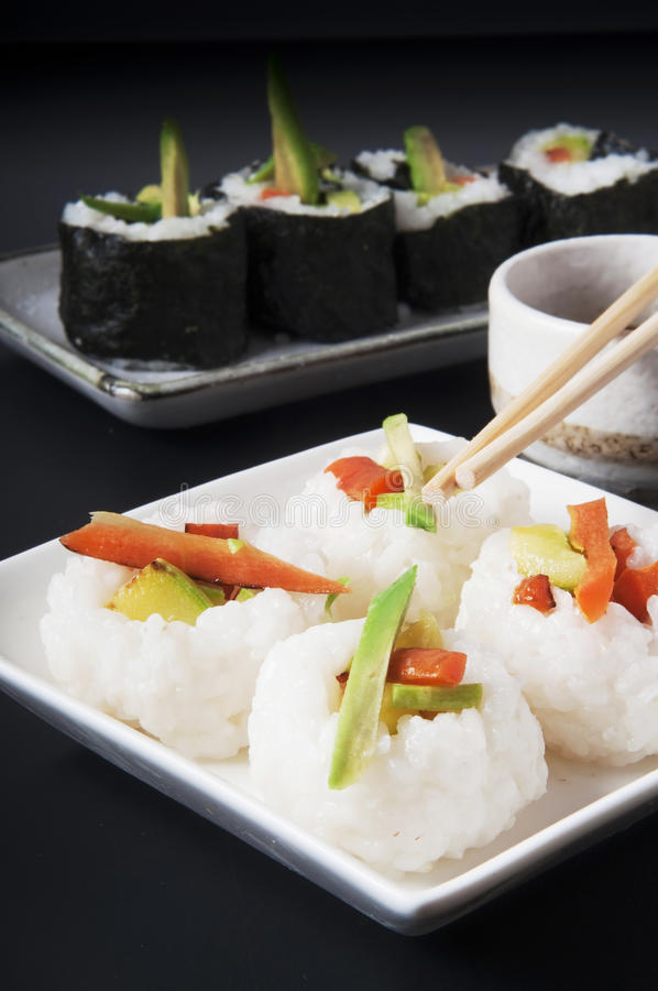 Japanese food. Veggie sushi and rice balls stock images