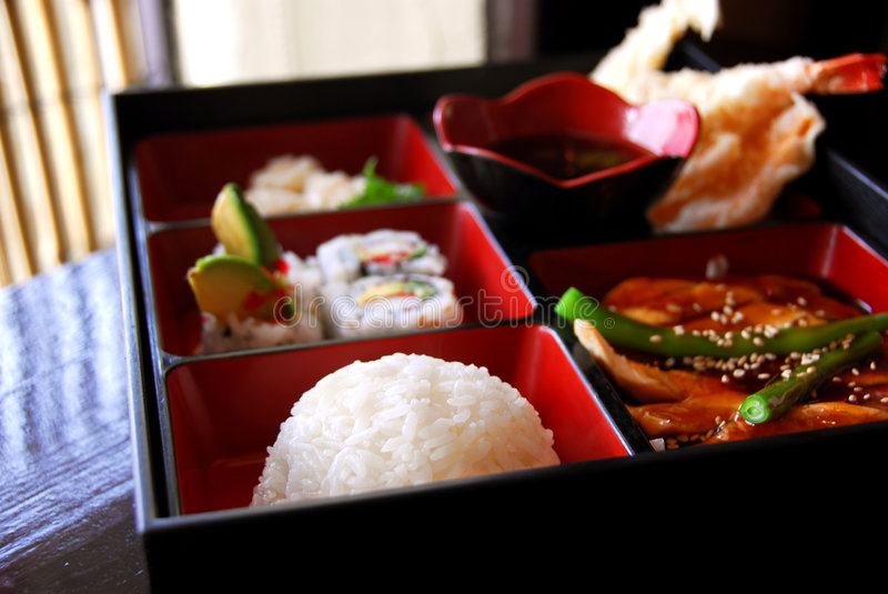 Japanese food. Assorted japanese food bento served a wooden box stock photo