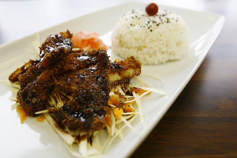Japanese food. Bento. Crispy Chicken (katsu) with teriyaki sauce and rice royalty free stock photos