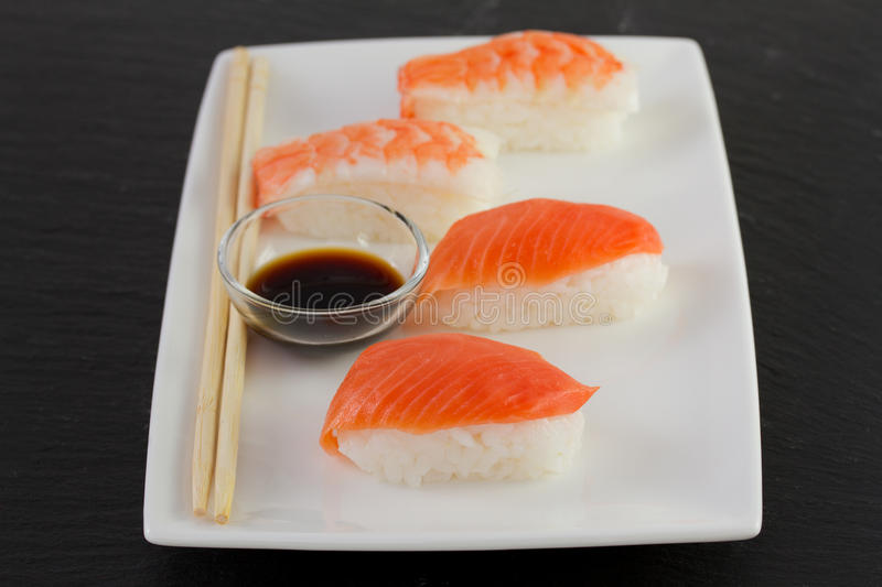 Japanese food on the dish. Japanese food on the white dish royalty free stock image
