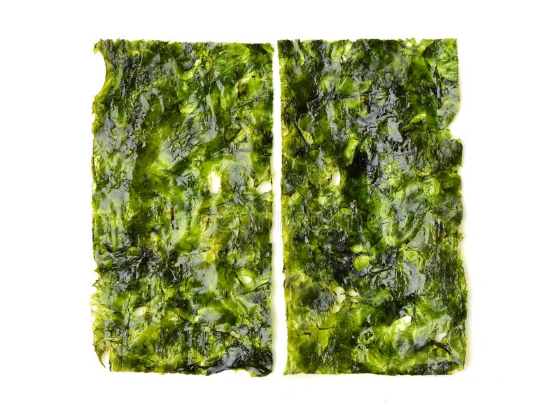 Japanese food nori dry seaweed sheets with salt and chopsticks royalty free stock photography