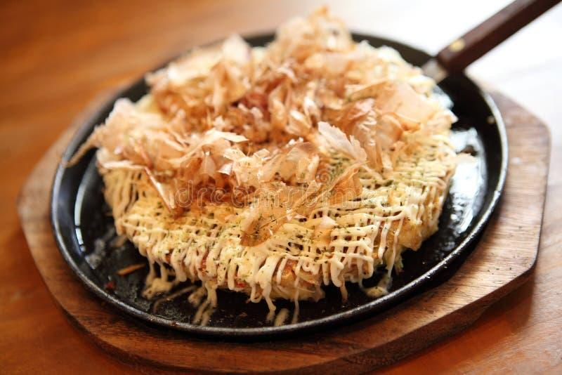 Japanese food okonomiyaki , Japanese pizza. In close up royalty free stock photography