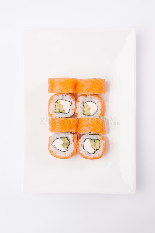 Japanese food restaurant, colorful rolls, gunkan and sushi platter. Set with chopsticks, soy sauce, ginger and wasabi. Top view on royalty free stock images